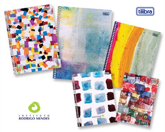 Em fundo branco, há cadernos de espiral com capas estampadas com obras de arte abstratas e coloridas. No canto inferior esquerdo está o logotipo do Instituto Rodrigo Mendes e, no canto superior direito, o logotipo da Tilibra.